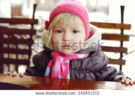 baby girl  in outdoor cafe - stock photo