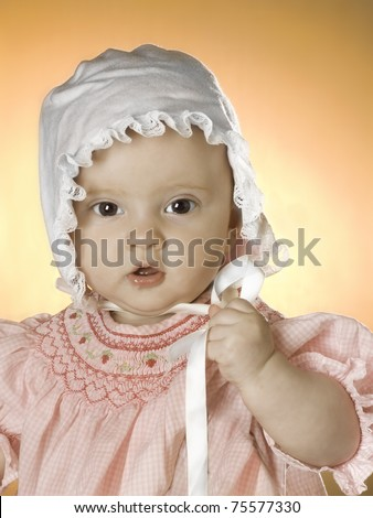Baby girl in pink - stock photo