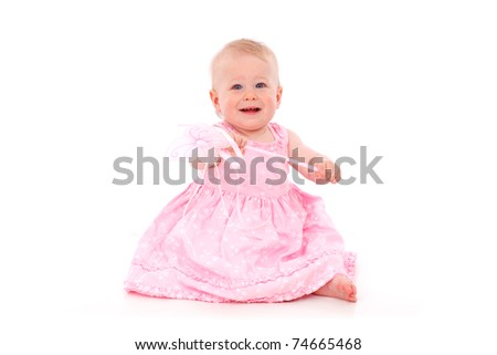 baby girl in pink isolated on white background