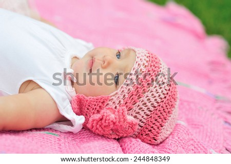 baby girl in pink knitted hat. - stock photo