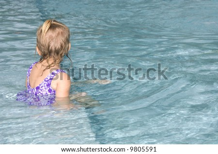 Baby Girl in Pool - stock photo