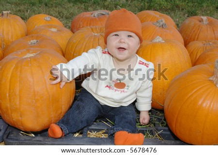 Baby Girl in Pumpkin Patch - stock photo