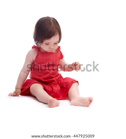 baby girl in red dress isolated on white background  - stock photo