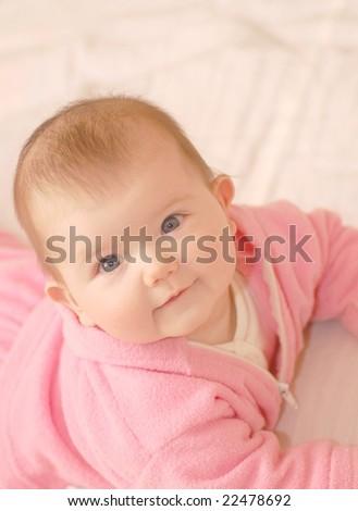 Baby girl in rose dress - stock photo
