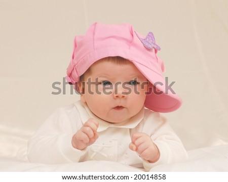 Baby girl in rose hat - stock photo