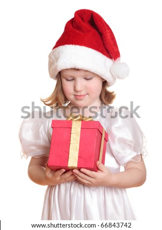 Baby girl in Santa's hat holding her Christmas present, isolated on white background. - stock photo
