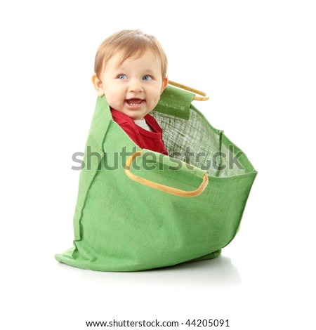 Baby girl in shopping bag, isolated on white - stock photo