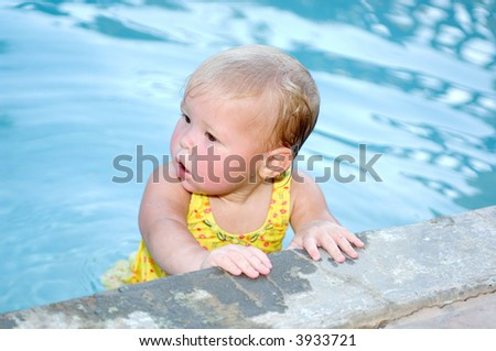 Baby Girl in Swimming Pool - stock photo