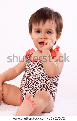 baby girl in swimsuit isolated over white background. photography