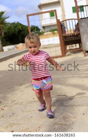 Baby girl in the playground - stock photo