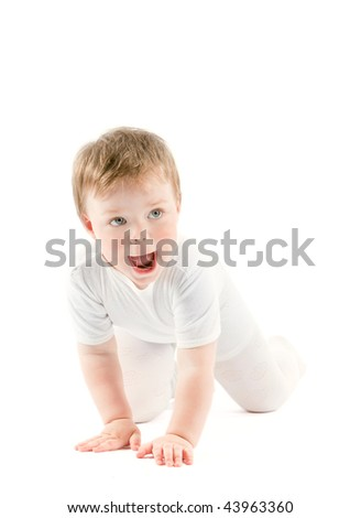 Baby girl in white clothes crawl on a white floor