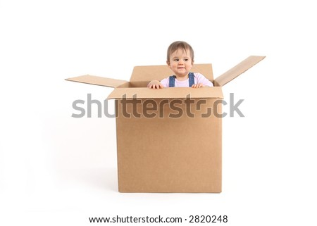 baby girl inside box, smiling - stock photo
