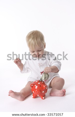 Baby girl is saving dollars for the future - stock photo