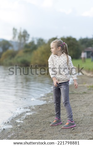 Baby girl jumping on a beach