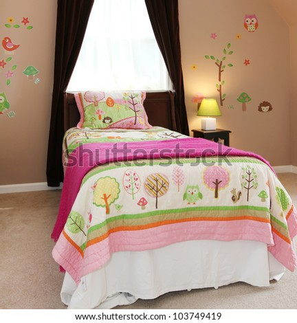 Baby girl kids bedroom interior with pink bed and brown walls.