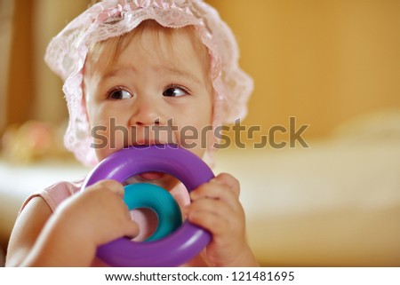 baby girl licking her toys - stock photo