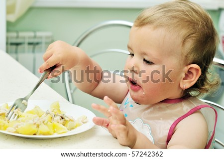 baby girl like eating with fork on her own