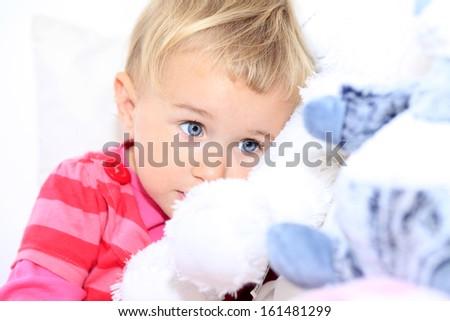 Baby girl loves her teddy bear - stock photo