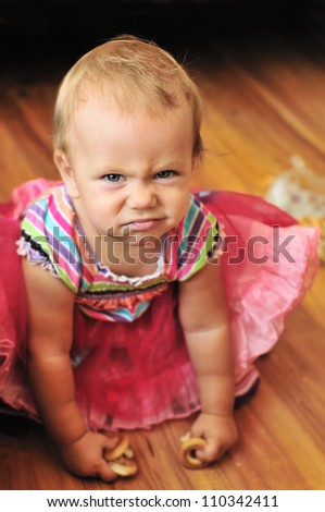 Stock Photo Baby Girl Make Funny Face In Soft Selective Focus