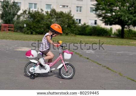 baby girl on bike - stock photo