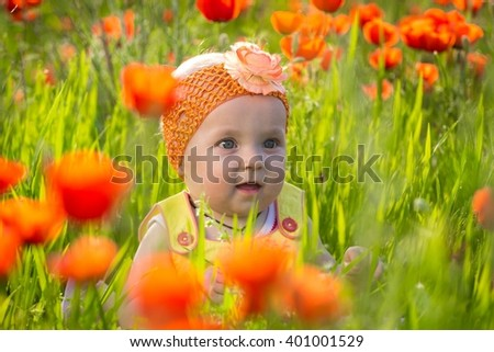 Baby girl on the flower filed