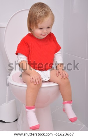 baby girl on the toilet - stock photo