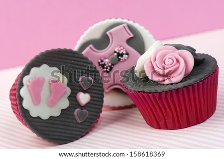 Baby girl pink cupcakes for baby shower - stock photo