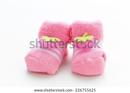 Baby girl pink shoes  on white background - stock photo