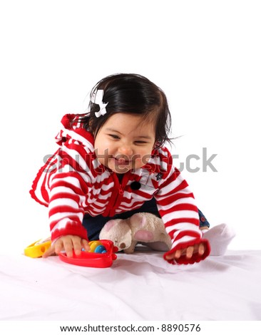 baby girl playing  and having fun - stock photo