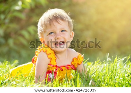 Baby girl playing in the garden - stock photo