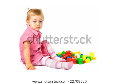 Baby girl playing with building blocks