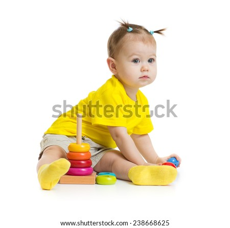 baby girl playing with colorful pyramid isolated - stock photo