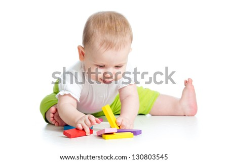 baby girl playing with colorful toys, isolated on white background