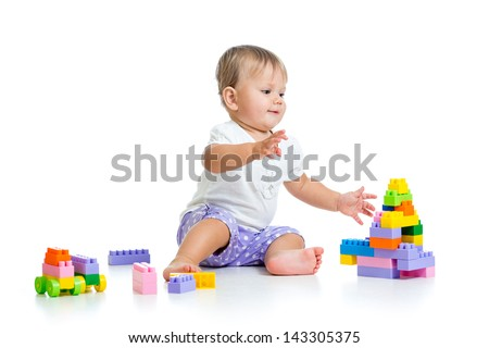 baby girl playing with construction set toy - stock photo