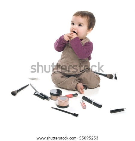 Baby girl playing with cosmetics, white background - stock photo