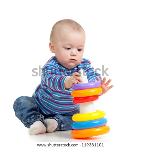 baby girl playing with toy isolated on white background - stock photo