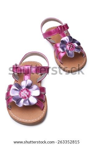 Baby girl sandals on white background - stock photo