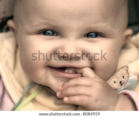 baby girl - sepia - stock photo