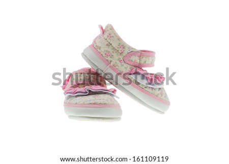 Baby girl shoes isolated on white background