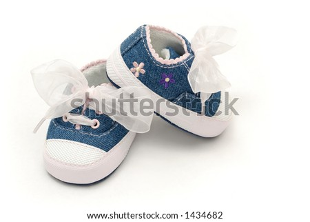 Baby Girl Shoes with White Bow and Pink Flowers - stock photo