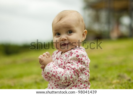 Baby Girl sitting at the Park - stock photo