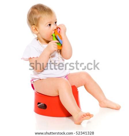 Baby girl sitting on pot isolated on white - stock photo