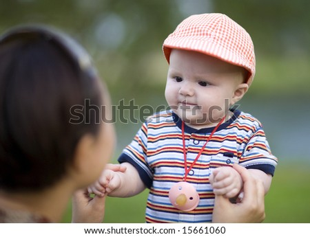 baby girl - six months old girl play with her mother - stock photo