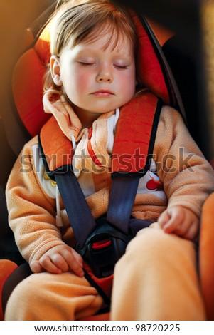 baby girl sleeps in car - stock photo