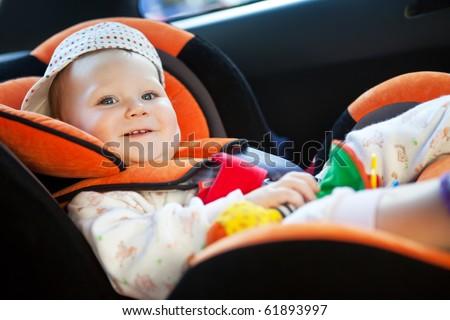 baby girl smile in car - stock photo