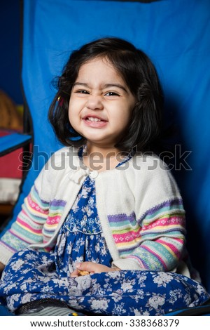 Baby girl smiling, cheerful, winter