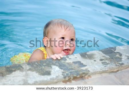 Baby Girl Swimming in Pool - stock photo