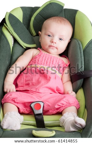 Baby girl toddler in a car seat - stock photo