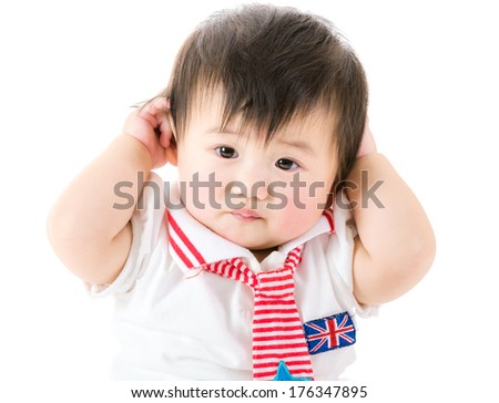 Baby girl touch ear - stock photo