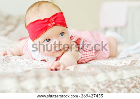 baby girl trying to keep her head - stock photo
